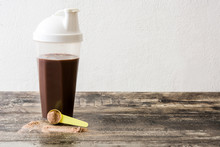 Chocolate Protein Shake On Wooden Table. Copyspace