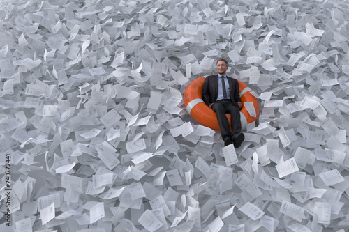 Fotografering businessman are floating on the sea of paper