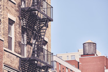 Old Building Fire Escape, Retro Color Toning Applied, New York City, USA.