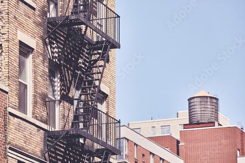 Fotografia, Obraz Old building fire escape, retro color toning applied, New York City, USA