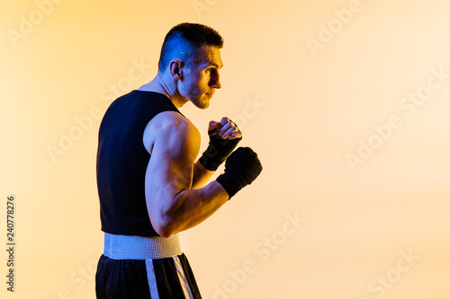 studio portrait of a fighter in defense position Wallpaper Mural