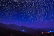 Beautiful Star Trails Above High Mountain At Night, Tham Sakoen View Point Attraction On Route 1148 Phayao-Nan, Tham Sakown National Park, Nan Province, Northern Of Thailand.