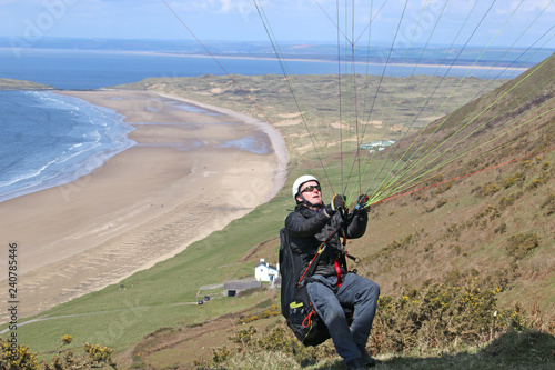 Paraglider reverse launching at Rhossili