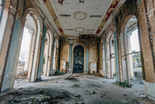 Ruined Large Hall Interior Overgrown By Plants And Moss
