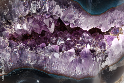 Fototapeta  Macro Mineral Stone Amethysts in the rock on a white background