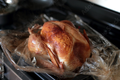 Freshly baked turkey resting on the stove top.