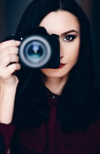 Portrait Of Young Woman Taking Photo With Dslr Camera.