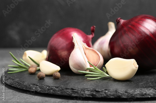 Valokuvatapetti Composition with garlic and onion on slate plate