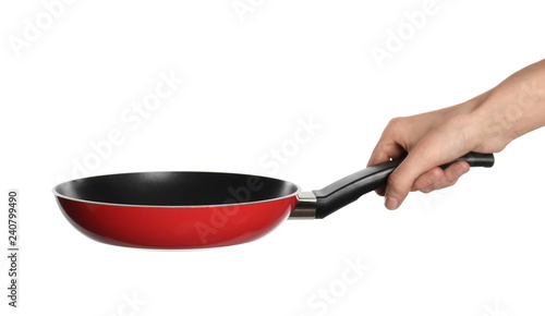 Woman holding new clean frying pan on white background