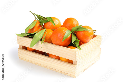 Wooden crate with tasty ripe tangerines on white background