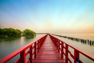 Long Red Bridge sunlight sky tree at beach sea,Red bridge Samut Sakhon Thailand