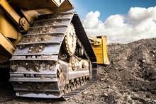 Bulldozer At Construction Site Working On Soil Arrangement