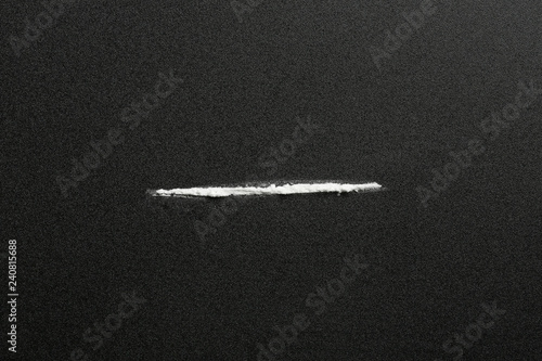Line of cocaine on dark background, top view Wallpaper Mural