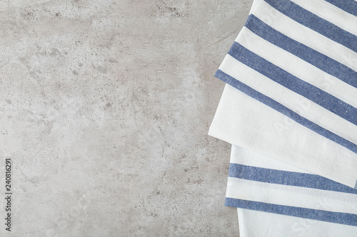 Fabric napkins and space for text on gray background, top view