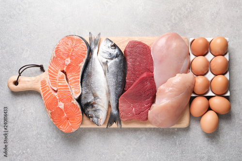 Set of natural food high in protein on grey background, top view