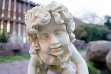 Cherub Statue In The Garden