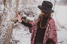 Stylish Latina Hipster Girl In Modern Native American Style, Knitted Cardigan With Ornament And Fedora Hat