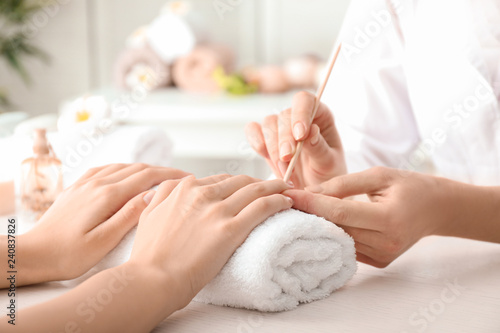 Young woman getting beautiful manicure in salon