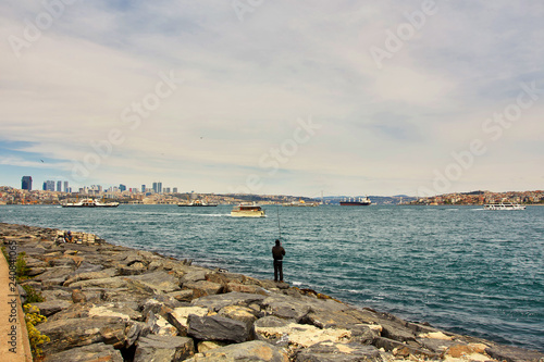 Fotografia  Bosphorus with a old town on a background