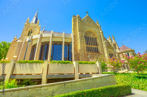 Staande foto Oceanië Side view of St Mary's Cathedral with stained glass in Perth, Western Australia. The garden around the Cathedral in neogothic style. Summer season. Blue sky. Landmarks in Perth Capital of WA.