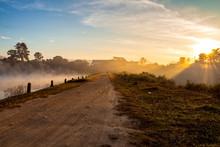 Dried Dirt Road And Lake At Morning Sunrise