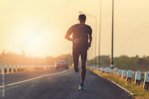 Foto  Athlete runner feet running on road