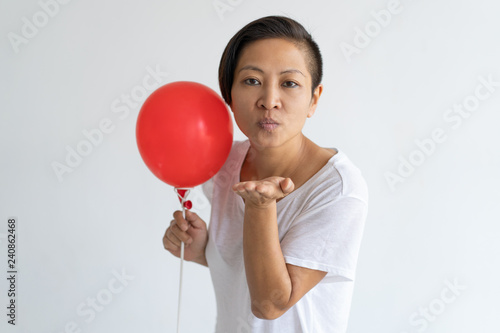 ab308a4b8840 Serious lady looking at camera and wearing t-shirt. Party and flirting  concept. Isolated front view on white background.