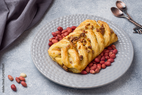 Fotografie, Obraz  Puff pastry with peanuts and caramel filling for Breakfast.