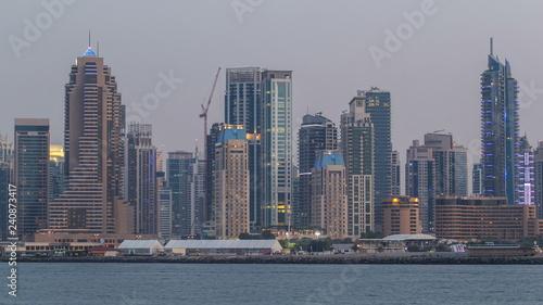 In de dag Chicago Dubai Marina skyline day to night timelapse as seen from Palm Jumeirah in Dubai, UAE.