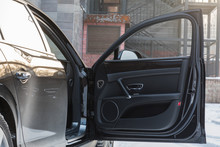 Open Door Of The Car Black Leather Car Interior