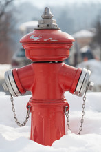 Red Fire Hydrant On The Street. Fireplug In The Snow