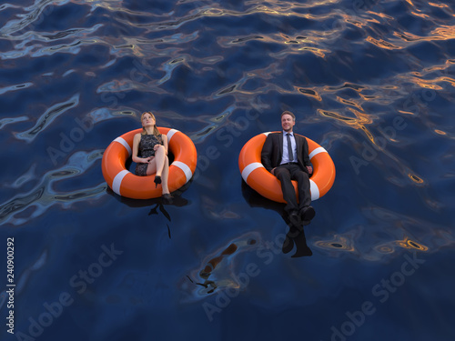 Fotografia  two office workers are floating on the rescue buoys, top view