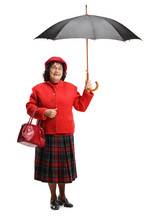 Senior Lady In A Red Coat Hold...