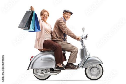 Senior couple with shopping bags on a vintage scooter