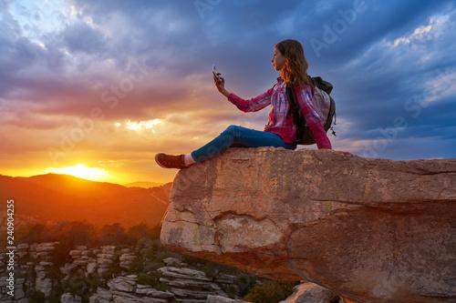 Hiker teen girl selfie phone on peak of mountain Canvas Print
