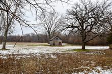 Abandoned Farm Shed In An Open Field