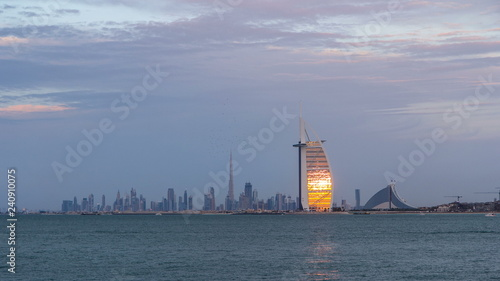 фотография Dubai skyline with Burj Al Arab hotel during sunset and day to night timelapse