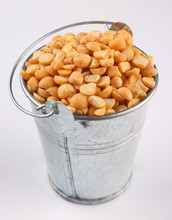 Yellow Chopped Peas In A Bucket On A White Background