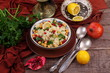 Vegetarian dish of couscous and vegetables with pomegranate and chickpeas