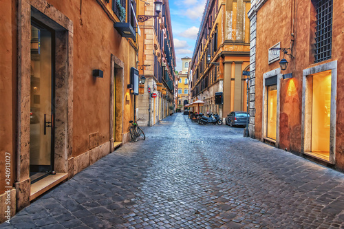Foto auf AluDibond Schmale Gasse Narrow Rome street in the downtown, Italy, no people