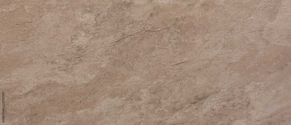 Fototapeta ceramic brown tile with rough abstract stone surface pattern