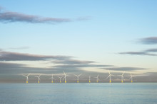 Wind Farm In North Sea Ocean Floating Turbines On Horizon Offshore At Aberdeen To Generate Energy And Electricity