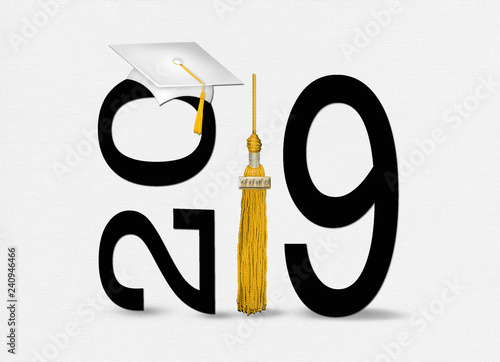 Fotografia  white 2019 graduation cap on black text with gold tassel isolated on soft textur