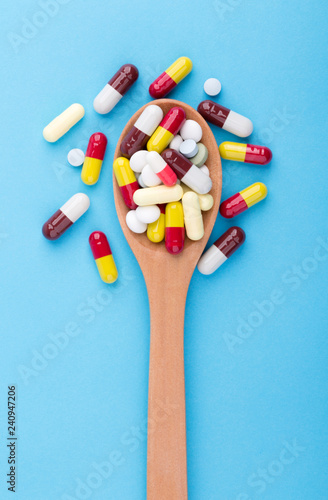 Medicine Pills Tablets And Capsules On Wooden Spoon