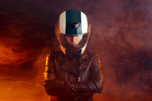 Biker Woman With Helmet And Le...