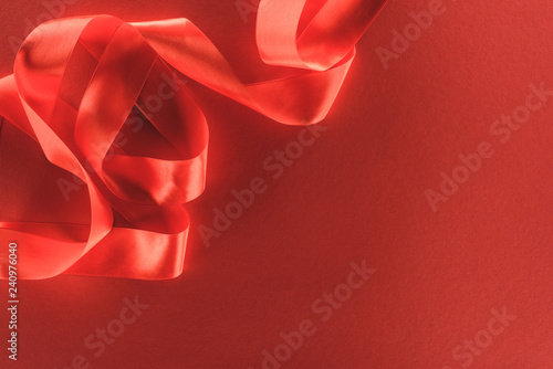 top view of red festive ribbon isolated on red, st valentine day concept