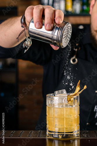 bartender at the bar making a cocktail