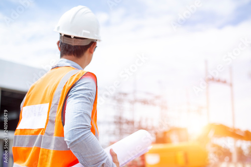 Fototapety, obrazy: Asiatic engineers are work inspecting the electric building
