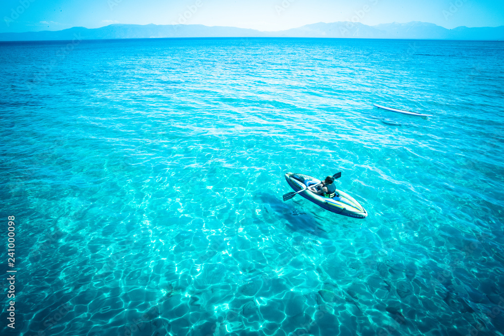 Fototapeta View from Lake Tahoe with tropical blue color water and canoe