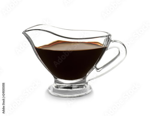 Glass gravy boat with balsamic vinegar on white background